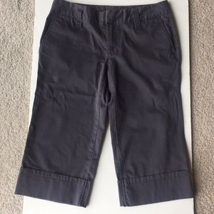 Gray stretch capris size 2 cuffed at ankle.